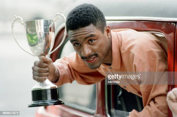 Michael Watson with the British Commonwealth middleweight trophy after defeating Nigel Benn 22nd May 1989