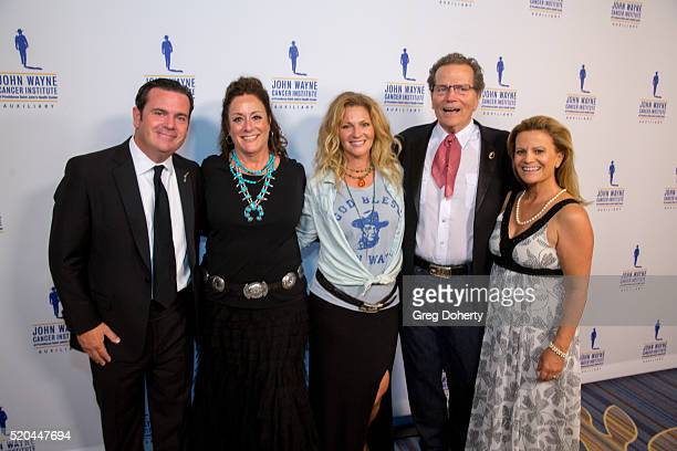 Michael Wayne Auxiliary President of the John Wayne Cancer Institute Anita Swift Marissa Wayne Chairman Patrick Wayne and Melanie Wayne attend the...