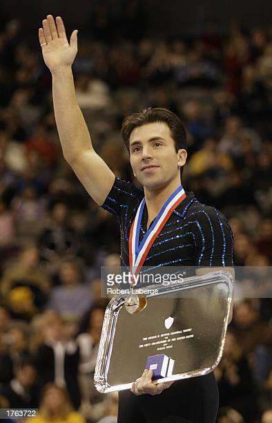 Michael Weiss poses on the winner's podium with his gold medal after the State Farm US Figure Skating Championships on January 18 2003 at the...