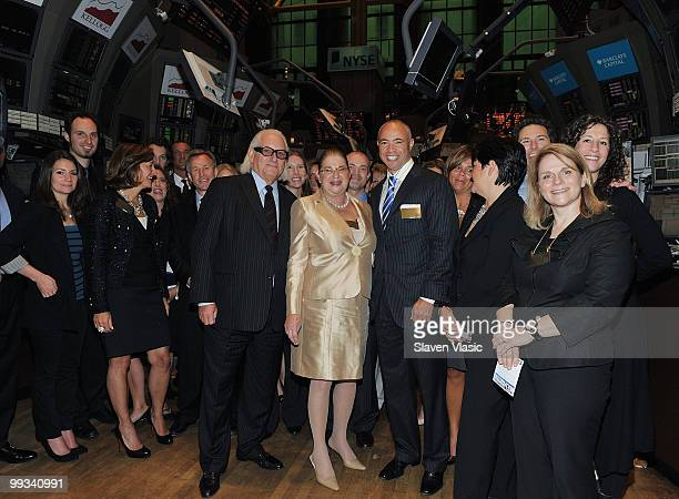 Michael Weiss President CEO Express Inc Arlene Weiss and Stefan Kaluzny Chairman of the Board Express Inc attend the opening bell at the New York...
