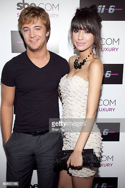Michael Welch and Christian Serratos attend Mi6 Nightclub Grand Opening Party on September 15 2009 in West Hollywood California