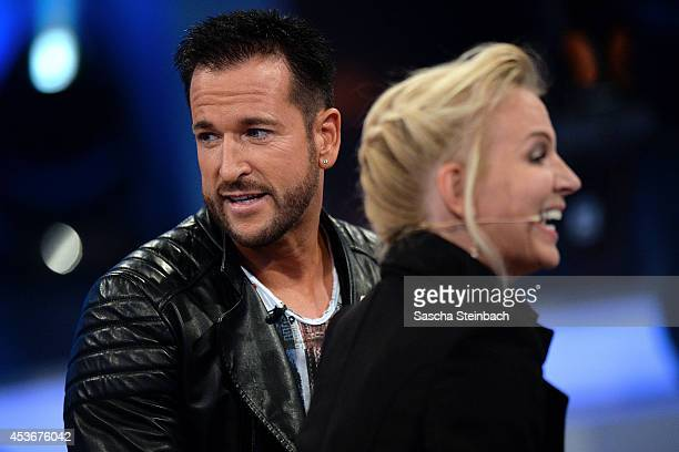 Michael Wendler and his wife Claudia Norberg attend the first live show of Promi Big Brother at Coloneum on August 15 2014 in Cologne Germany