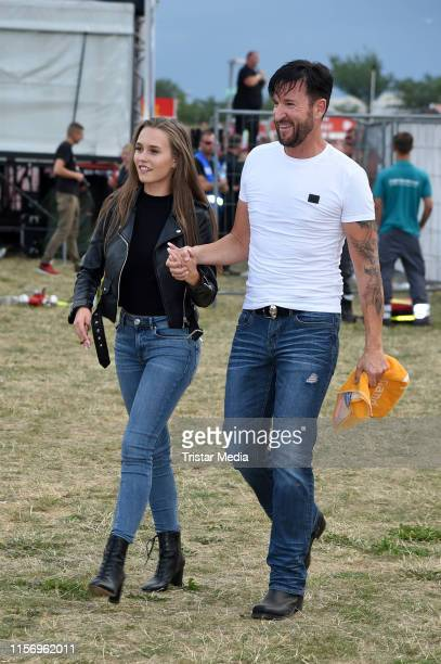 Michael Wendler and Laura Mueller attend the Rostock Ole Schlagerparty at IGAPark on July 20 2019 in Rostock Germany
