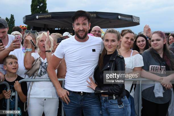 Michael Wendler and Laura Mueller pose with fans during the Rostock Ole Schlagerparty at IGAPark on July 20 2019 in Rostock Germany