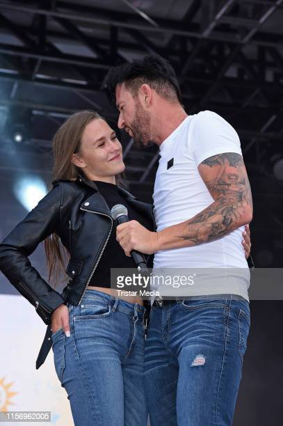 Michael Wendler and Laura Mueller seen onstage during the Rostock Ole Schlagerparty at IGAPark on July 20 2019 in Rostock Germany