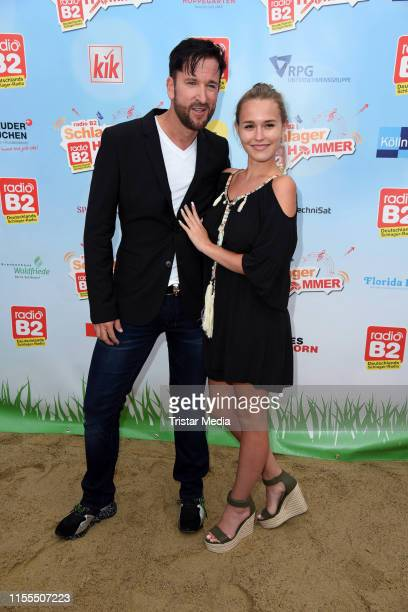 Michael Wendler and Laura Muller during the Radio B2 SchlagerHammer Festival at Racecourse Hoppegarten on July 13 2019 in Berlin Germany