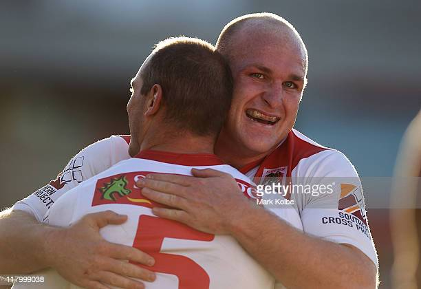 Michael Weyman congratulates Reece Simmonds of the Dragons after he scored a try during the round 17 NRL match between the St George Illawarra...