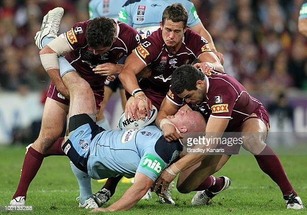 Michael Weyman of the Blues is tackled during game two of the ARL State of Origin Series between the New South Wales Blues and the Queensland Maroons...