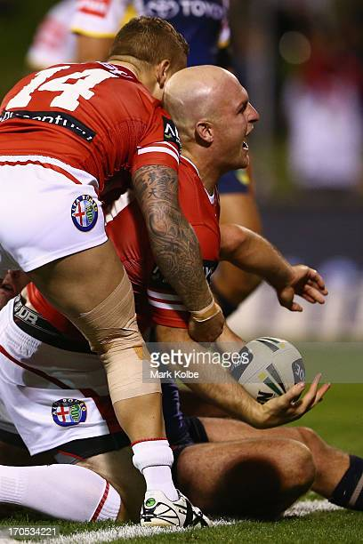 Michael Weyman of the Dragons celebrates scoring a try during the round 14 NRL match between the St George Illawarra Dragons and the North Queensland...