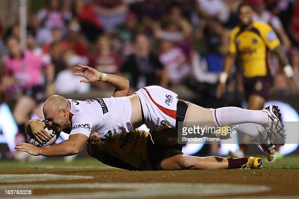 Michael Weyman of the Dragons dives to score the opening try for the Dragons during the round two NRL match between the St George Dragons and the...