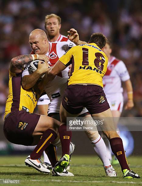 Michael Weyman of the Dragons is tackled by the Broncos defence during the round two NRL match between the St George Dragons and the Brisbane Broncos...