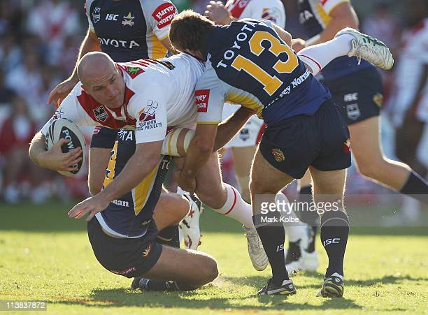 Michael Weyman of the Dragons is tackled during the round nine NRL match between the St George Illawarra Dragons and the North Queensland Cowboys at...