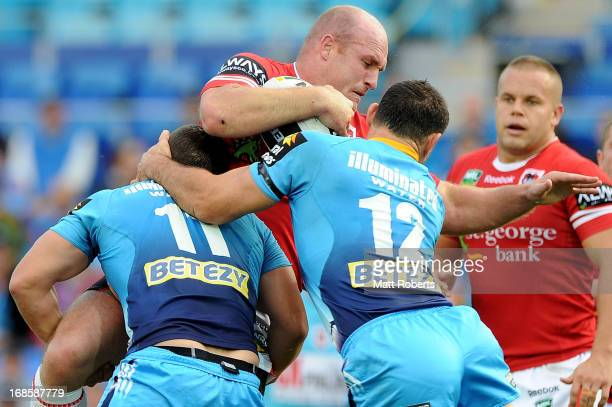 Michael Weyman of the Dragons is tackled during the round nine NRL match between the Gold Coast Titans and the St George Illawarra Dragons at Skilled...