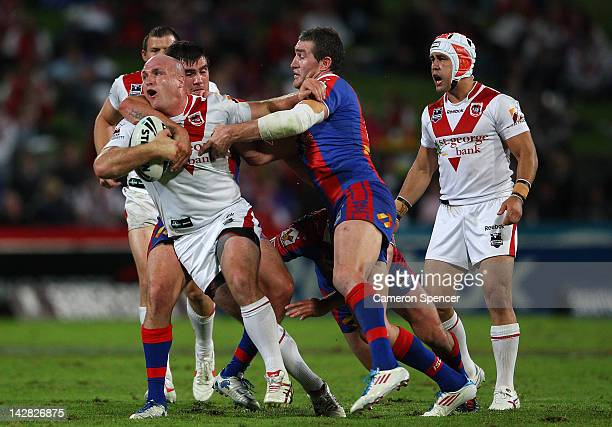 Michael Weyman of the Dragons is tackled during the round seven NRL match between the St George Illawarra Dragons and the Newcastle Knights at WIN...