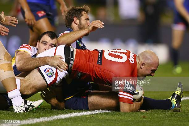 Michael Weyman of the Dragons scores a try during the round 14 NRL match between the St George Illawarra Dragons and the North Queensland Cowboys at...