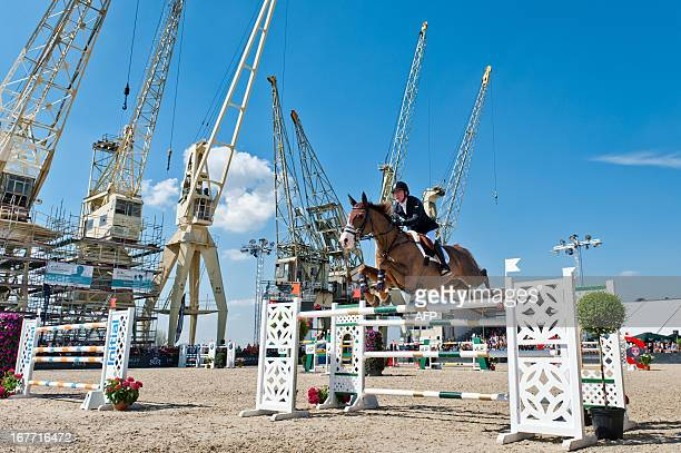 Michael Whitaker of Britain rides Viking at the Grand Prix of the sixth edition of Antwerp jumping, on April 28, 2013. AFP PHOTO / BELGA / JONAS...