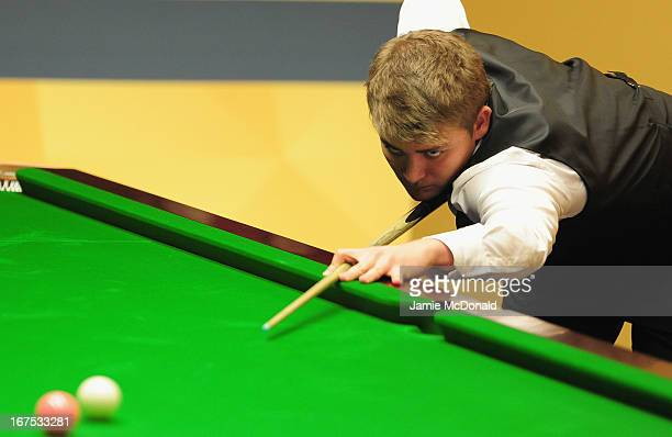 Michael White in action during his second round match against Dechawat Poomjaeng during the Betfair World Snooker Championship at the Crucible...