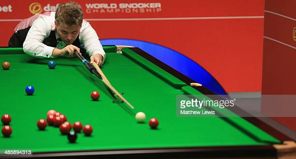 Michael White of Wales in action agsint Mark Selby of England during day four of the The Dafabet World Snooker Championship at Crucible Theatre on...