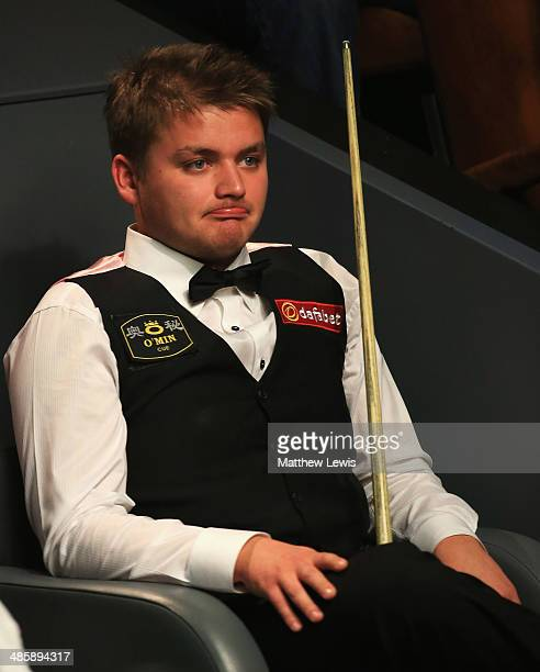 Michael White of Wales looks on during his match against Mark Selby of England during day four of the The Dafabet World Snooker Championship at...