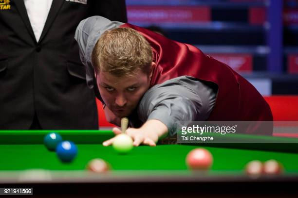 Michael White of Wales plays a shot during his first round match against Judd Trump of England on day two of 2018 Ladbrokes World Grand Prix at Guild...