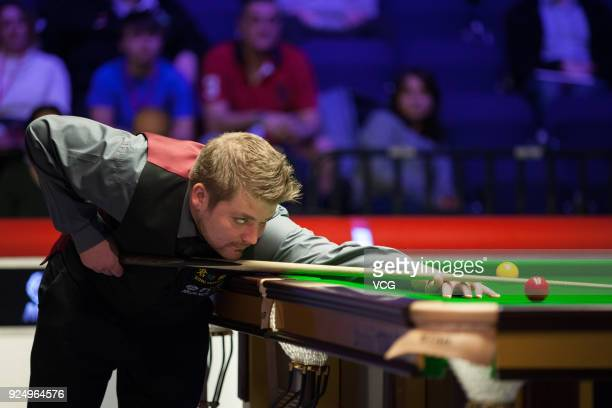 Michael White of Wales plays a shot during his first round match against Martin Gould of England on day two of 2018 ManBetX Welsh Open at Motorpoint...