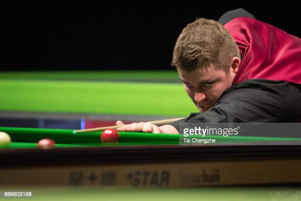 Michael White of Wales plays a shot during his third round match against Ronnie O'Sullivan of England on day 9 of 2017 Betway UK Championship at...