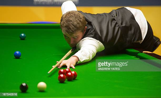 Michael White of Wales plays a shot during the World Snooker Championship 2013 second round match against Dechawat Poomjaeng of Thailand at The...