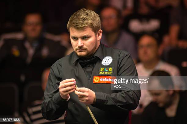 Michael White of Wales reacts during his second round match against Ding Junhui of China on day three of 2017 Dafabet English Open at Barnsley...