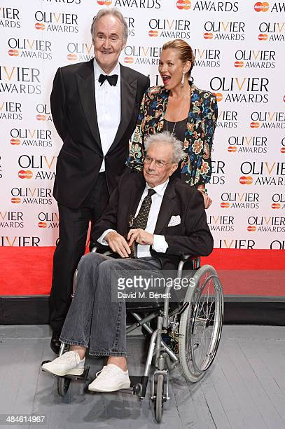 Michael White winner of the Special Award poses in the press room with presenters Nigel Planer and Kate Moss at the Laurence Olivier Awards at The...