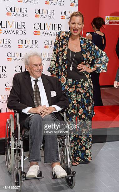 Michael White winner of the Special Award poses in the press room with presenter Kate Moss at the Laurence Olivier Awards at The Royal Opera House on...
