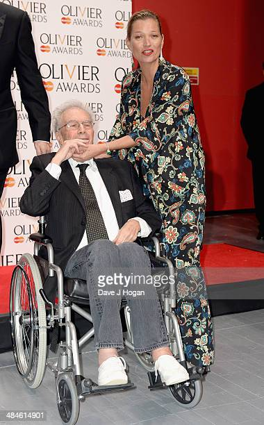 Michael White with his Special Award and Kate Moss during the Laurence Olivier Awards at the Royal Opera House on April 13 2014 in London England