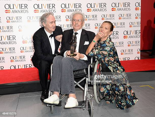 Michael White with his Special Award with award presnters Nigel Planer and Kate Moss during the Laurence Olivier Awards at the Royal Opera House on...