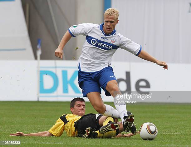 Michael Wiemann of Rostock and Marcus Steegmann of Koblenz battle for the ball during the Third League match between Hansa Rostock and TuS Koblenz at...