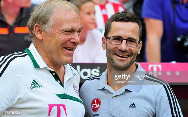 Michael Wiesinger head coach of Nuernberg talks to Hermann Gerland coach of Bayern Muenchen before the Bundesliga match between FC Bayern Muenchen...