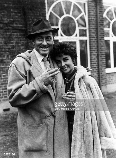"""Michael Wilding and Elizabeth Taylor, British actors, 1952."""" The Wildings at Shepperton Studios after their honeymoon. Elizabeth Taylor, who was born..."""