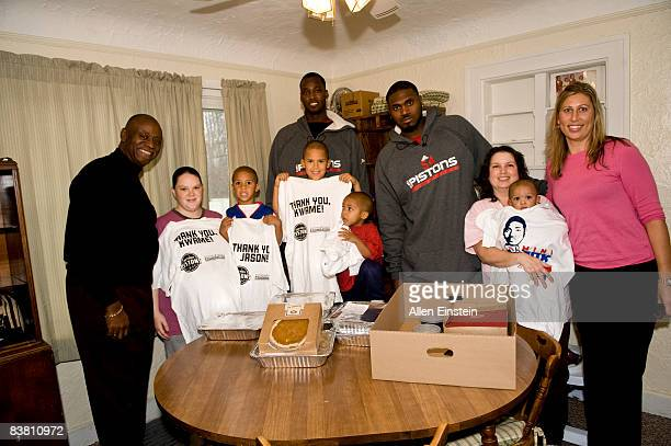 Michael Williams CEO of Orchards Childrens Services Kwame Brown and Jason Maxiell of the Detroit Pistons and Laura Donker supervisor at Orchards pose...