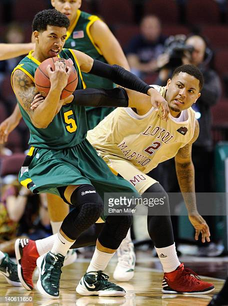Michael Williams of the San Francisco Dons steals the ball from CJ Blackwell of the Loyola Marymount Lions during a quarterfinal game of the...