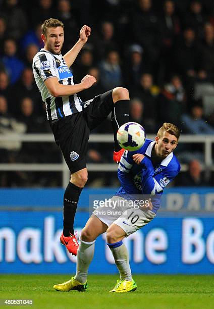 Michael Williamson of Newcastle United beats Gerard Deulofeu of Everton to the ball during the Barclays Premier League match between Newcastle United...