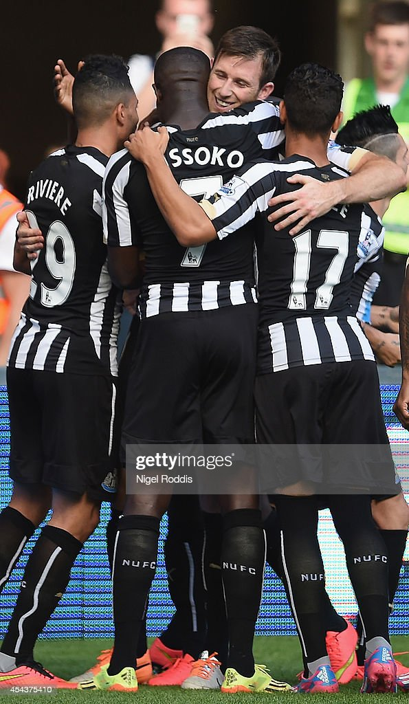 Michael Williamson of Newcastle United is congratulated by team mates on scoring his goal during the Barclays Premier League match between Newcastle United and Crystal Palace at St James' Park on August 30, 2014 in Newcastle upon Tyne, England.