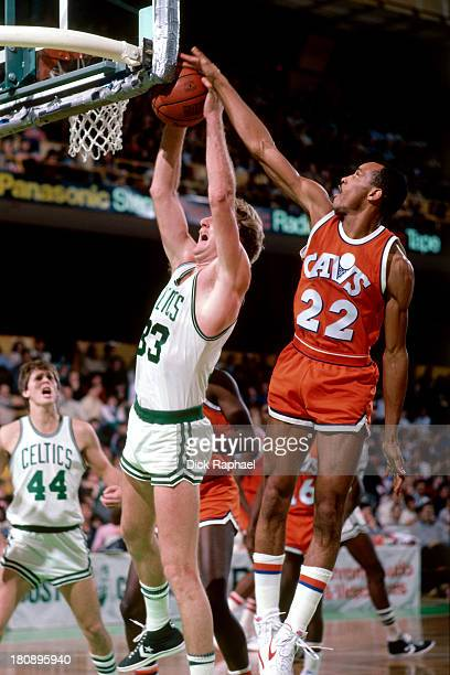 Michael Wilson of the Cleveland Cavaliers blocks a shot from Larry Bird of the Boston Celtics during a game circa 1985 at the Boston Garden in Boston...