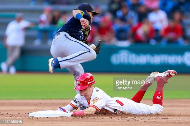 Michael Wing of Rieleros de Aguascalientes and Carlos Figueroa of Diablos Rojos in second base during a match between Rieleres de Aguascalientes and...