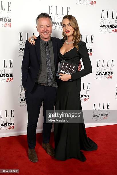 Michael Winterbottom poses with model Cara Delevingne, winner of the Breakthrough Actress Award, in the winners room during the Elle Style Awards...