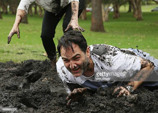 Michael Wipfli and Marta Dusseldorp participate in a mud fight to raise awareness about the 'Mud Pie Project' to help raise funds to complete the Ian...
