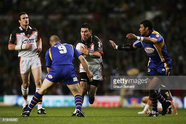 Michael Withers of Bradford is challenged by Matt Diskin of Leeds during the Tetley's Super League Grand Final between Bradford Bulls and Leeds...