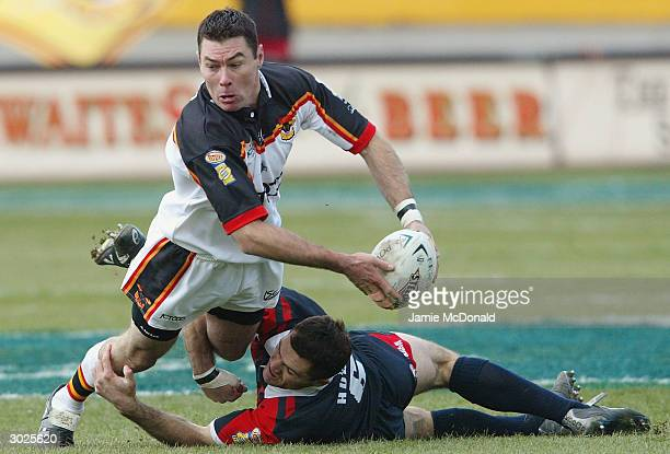 Michael Withers of Bradford is tackled by Jason Hooper of St Helens during the Powergen Challenge Cup match between Bradford Bulls and St Helens at...