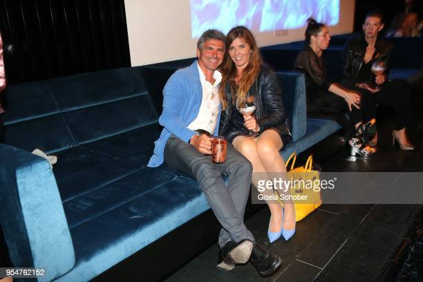 """Michael Wolf and his wife Angelika """"Angie"""" Wolf during the Grand Opening of Roomers Spa by Shan Rahimkhan on May 4, 2018 in Munich, Germany."""