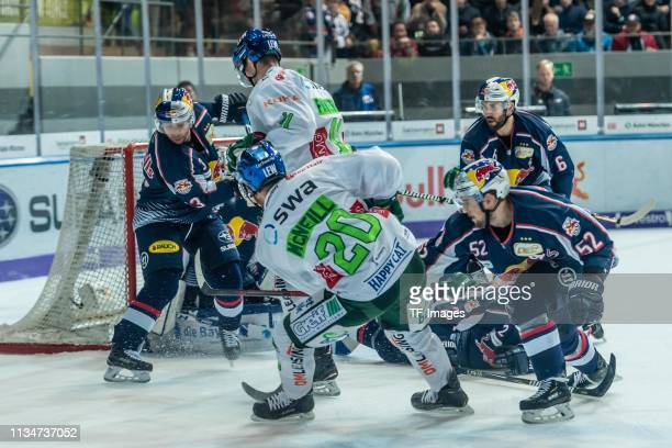 Michael Wolf of EHC Red Bull Muenchen, David Stieler of Augsburger Panther, goalkeeper Danny aus den Birken of EHC Red Bull Muenchen, Sahir Gill of...