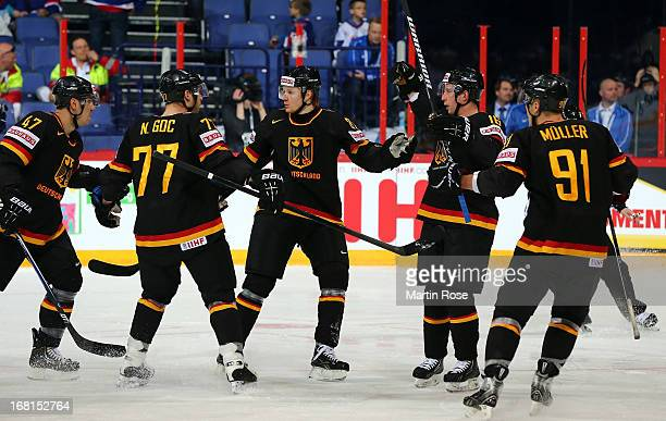 Michael Wolf of Germany celebrate with his team mates after he scores his team's opening goal during the IIHF World Championship group H match...