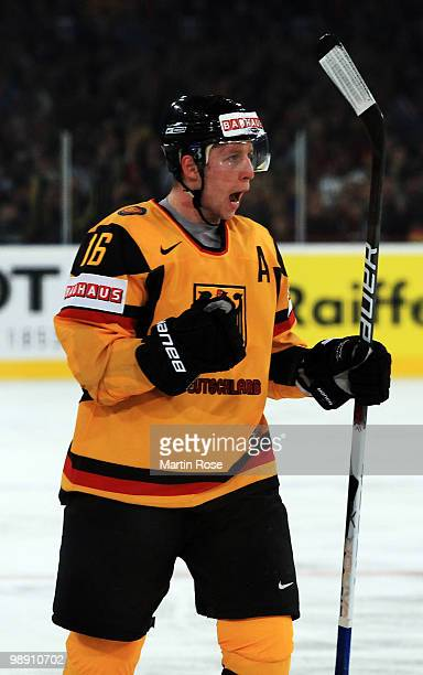 Michael Wolf of Germany celebrates after he scores his team's opening goal during the IIHF World Championship group D match between USA and Germany...