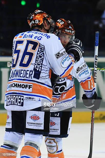 Michael Wolf of Iserlohn celebrates with his team mate Stefan Langwieder after scoring his team's winning goal during the DEL match between Hamburg...